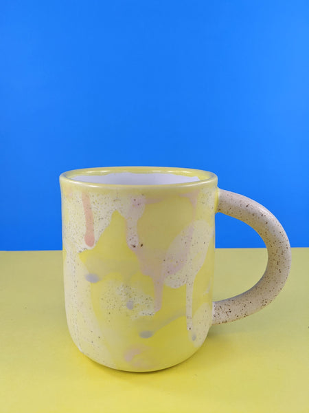Yellow splatter ceramic mug by Meg Hubert available at Local Assembly