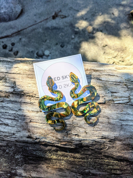Green snake earrings by Red Sky available at Local Assembly