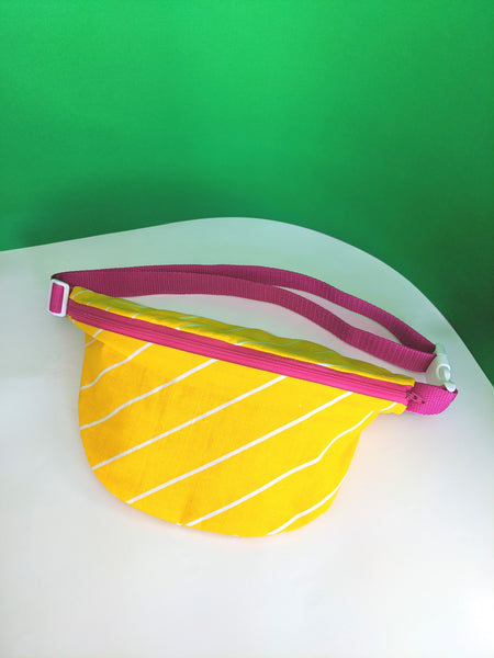Yellow striped fanny pack by Pep! available at Local Assembly