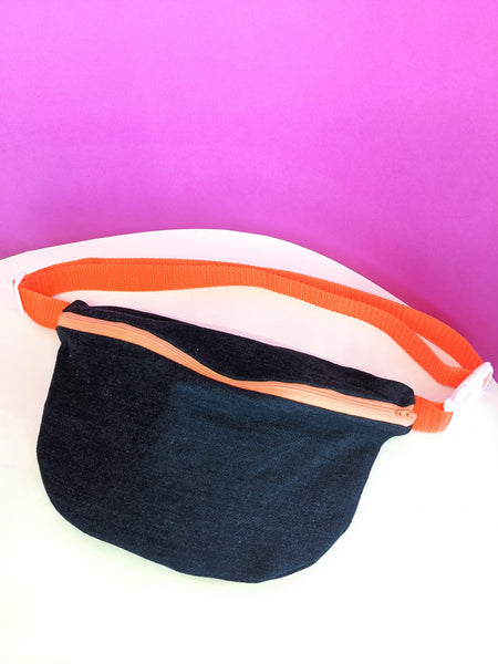 Dark denim fanny pack with an orange zipper and strap by Pep! available at Local Assembly