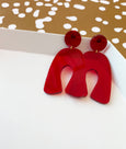 Red acrylic wishbone earring by Combinist Goods available at Local Assembly