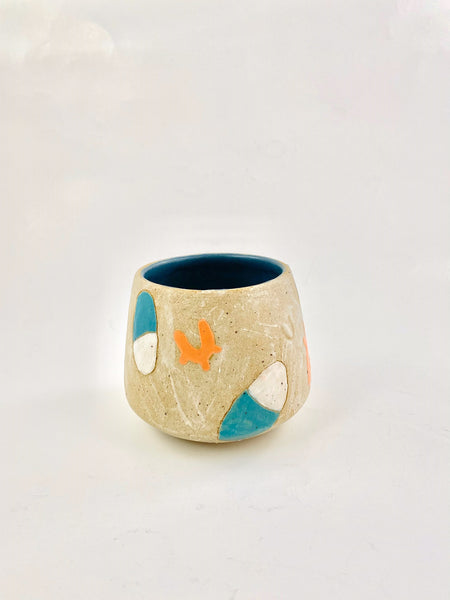 Brown stoneware mug with blue blob shapes on it by Coco Spadoni available at Local Assembly