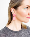 Pink acrylic earrings by Combinist Goods available at Local Assembly