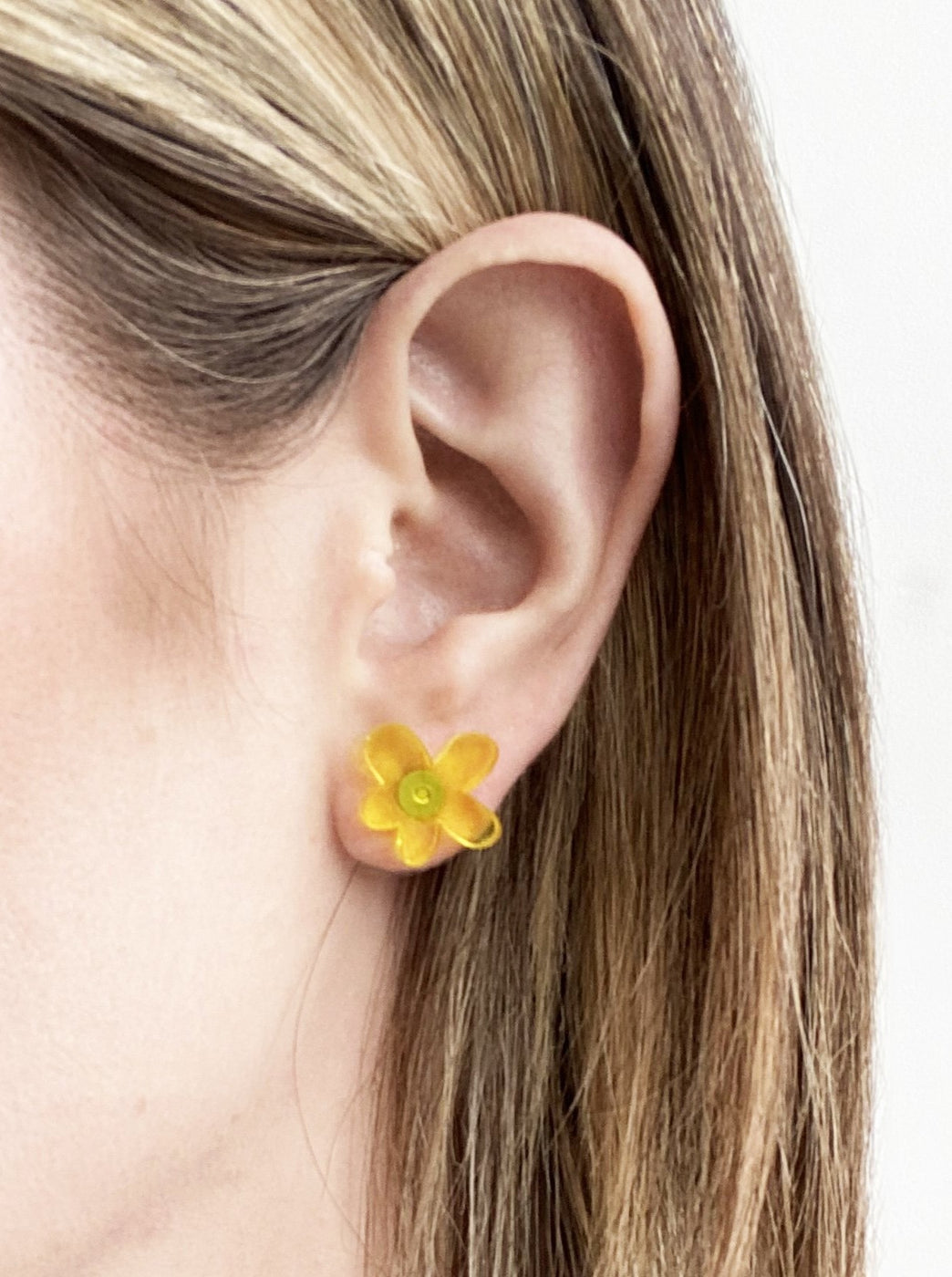Yellow acrylic daisy earrings by Combinist Goods available at Local Assembly