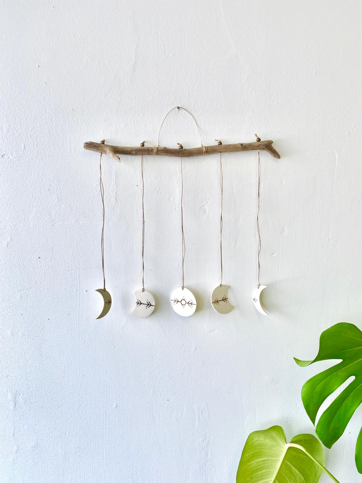 White and gold ceramic moon wall hanging by Mana Dejah available at Local Assembly