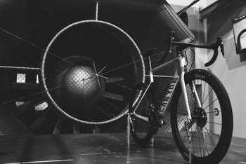<h1>Wind Tunnel Tested</h1><i>Developed by Luisa Grappone, with years in the wind tunnel spent testing every last detail. We've left no stone unturned in designing this wheelset from the ground up to be very fastest in the world within its class.</i>