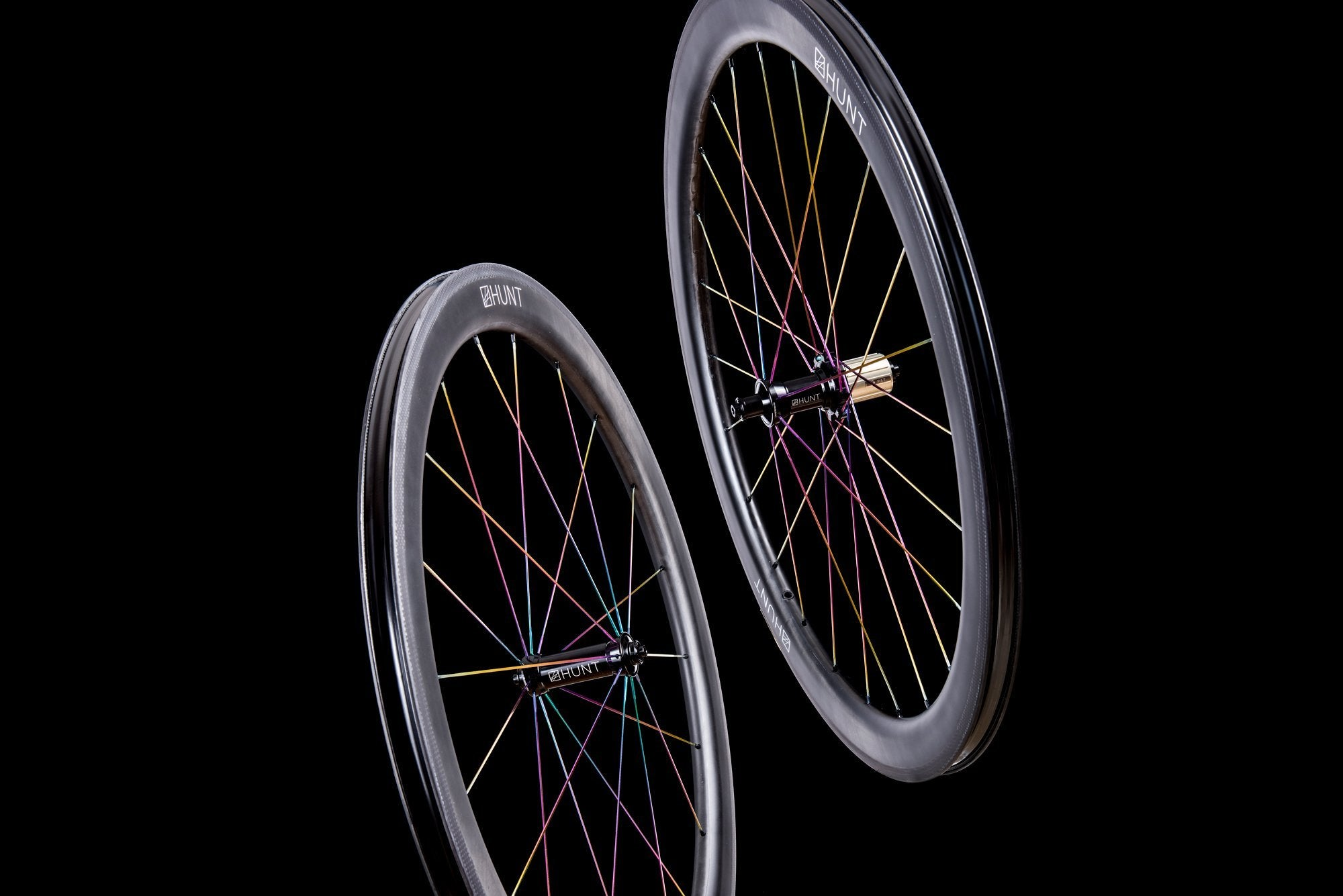 <h1>Oil-Slick Spokes</h1><i>We can also give the spokes a Ti-Nitride coating which not only gives them an eye-catching oil slick rainbow look but also improves wear and corrosion resistance due to the super-hard micro hardness of this coating. The coating is multi-compounded by ceramics and transition metal, so the bonding force between coating and base is immensely improved. This results in a really long lasting finish.</i>