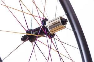 <h1>Hubs</h1><i>Precision machined straight pull hubs and spokes add strength and enhance power transfer meaning all your force pushes you forwards. Large 15mm diameter hub axles for sprinting and out-of-saddle climbing responsiveness. Circular dropout interface steps add extra stiffness.</i>