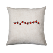 Red beads on a string cushion
