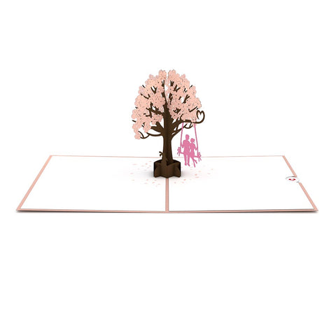 Lovers in a Dogwood Tree Pink Pop Up Anniversary Card greeting card -  Lovepop