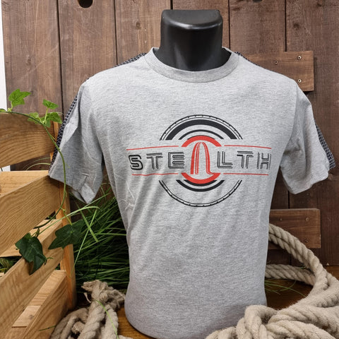 A light grey t-shirt with the Stealth logo printed across the middle in a black and red tyre design