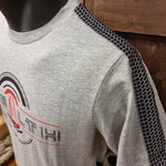 A close up of the t-shirt shoulder showing the tyre print taping running down the sleeve
