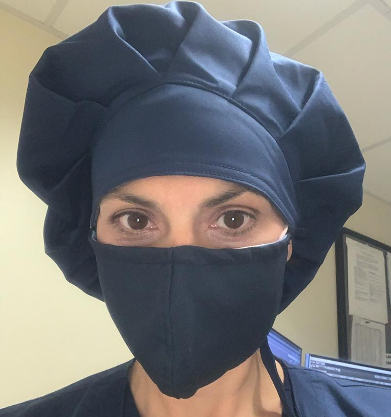 Healthcare worker wearing reusable face mask