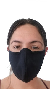 Blue reusable face mask being worn