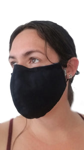 Blue reusable face mask being worn angle view