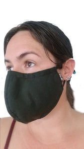 Black reusable face mask being worn angle view