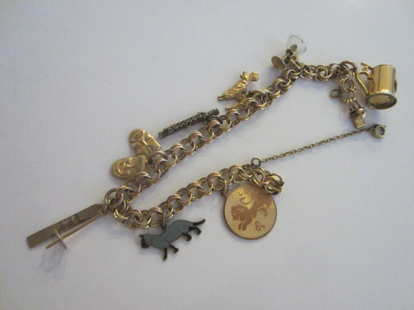 Charm Bracelet Symbolizing Various Characters On A Link Chain