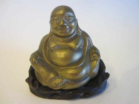 A Brass Buddha On Carved Mahogany Stand