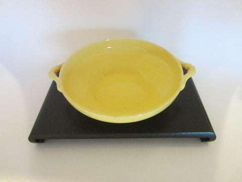 A Yellow Ceramic Candy Bowl With Two Handles