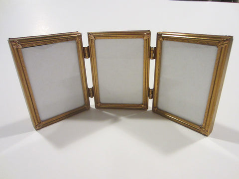 A Trifold Ornamental Brass Vintage Picture Frames