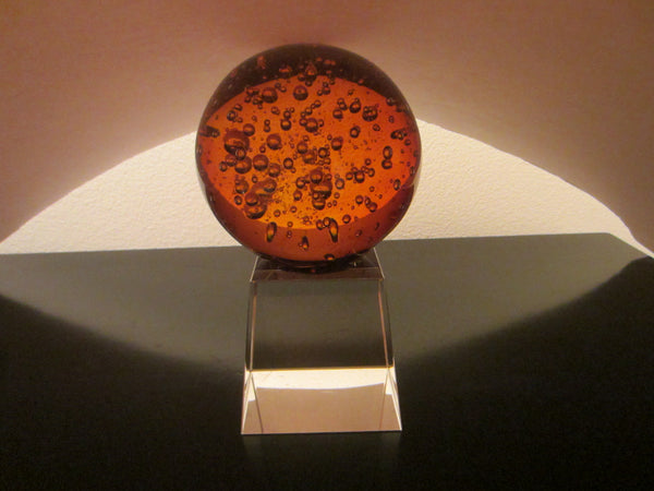 A Cased Blown Glass Sphere Paperweight Controlled Bubbles