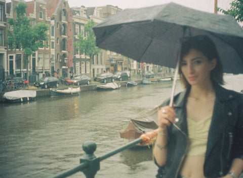 35mm film picture of a girl (blurred) in amsterdam city