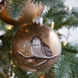 Decorated 8cm bird print bauble in Cashmere Brown or Winter White enamel finish
