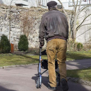 EV Rider Move-X Compact Rollator Folding 4-Wheel Walker RU4131 Being Used By Man On Paved Sidewalk