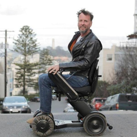 Image of Man Smiling While Riding WHILL Model Ci Travel/Portable Power Wheelchair 210-06874