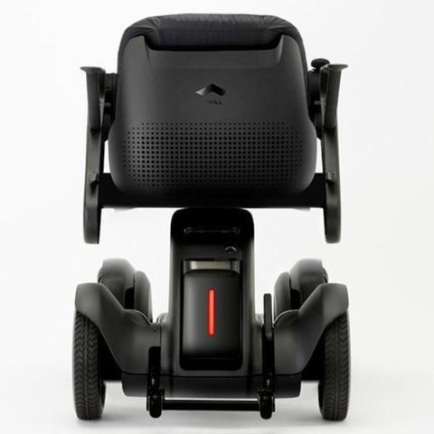 Image of WHILL Model Ci Travel/Portable Power Wheelchair 210-06874 Rear View Of Brake Light And Anti-Tip Wheels