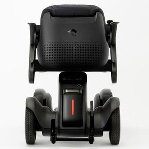 WHILL Model Ci Travel/Portable Power Wheelchair 210-06874 Rear View Of Brake Light And Anti-Tip Wheels