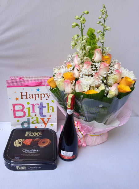 Birthday package with a bright water bouquet, wine and chocolate all at Simona Flowers and Gift Shop