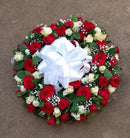 Standard round funeral wreath of white and red flowers by Simona Flowers