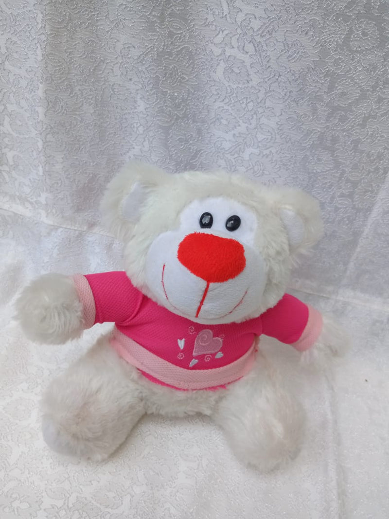 A small white teddy bear with a pink shirt to gift your favourite person on valentine's day by Simona Flowers