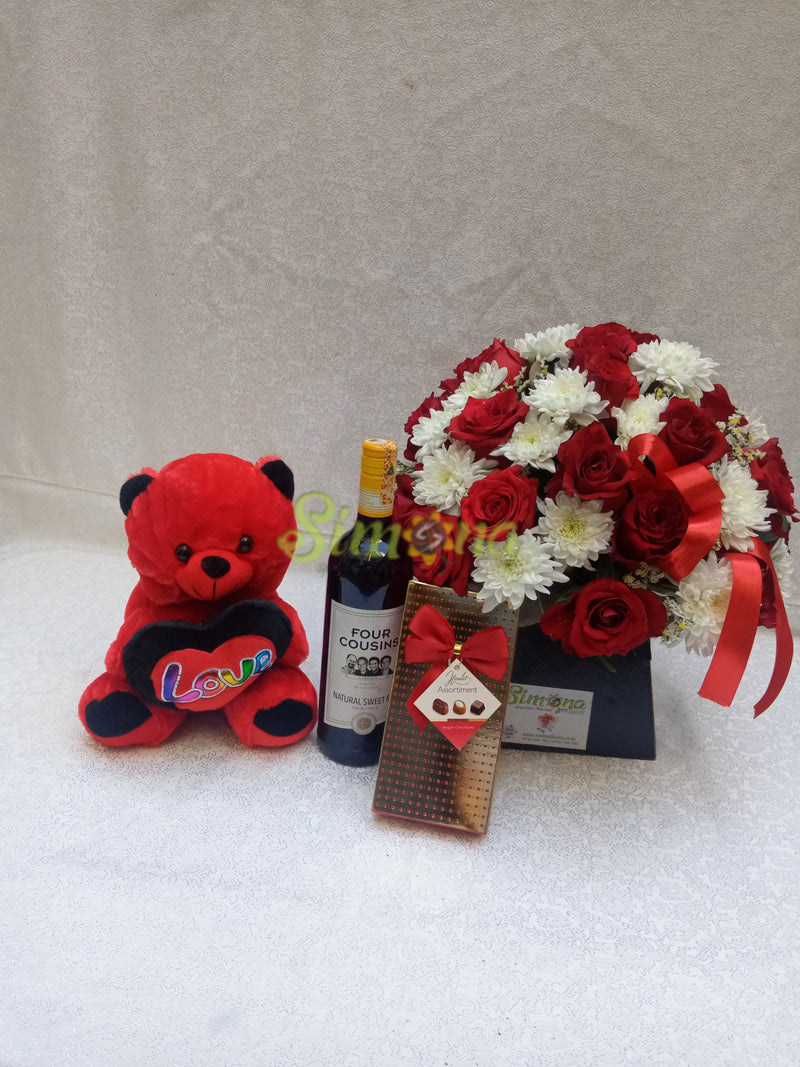 Adorable bouquet with dotted box hamlet chocolate, teddy bear and red wine