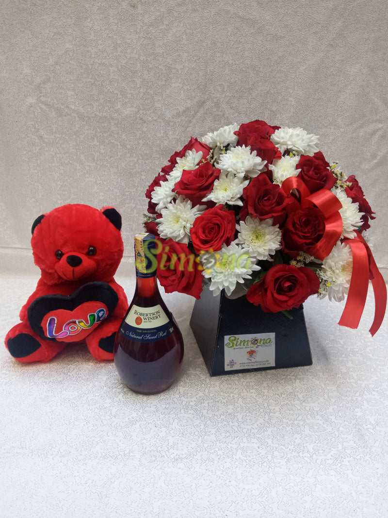 Adorable bouquet with teddy bear and red wine