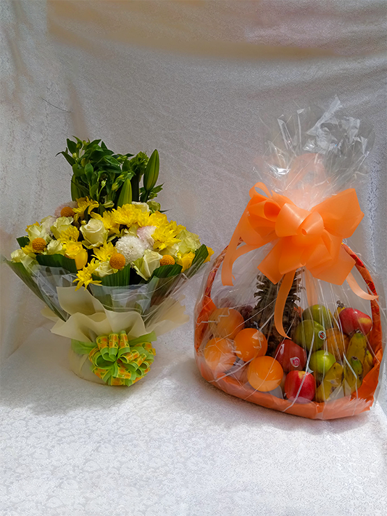 Agnes package of a water bouquet flower arrangement and fruit basket