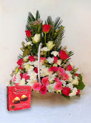 Beauty flower basket and guylian chocolate for customer service week offer by Simona Flowers