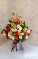 A royal box bouquet of Chrysanthemums, a touch of roses and orchids, fillers and Ammi Majus