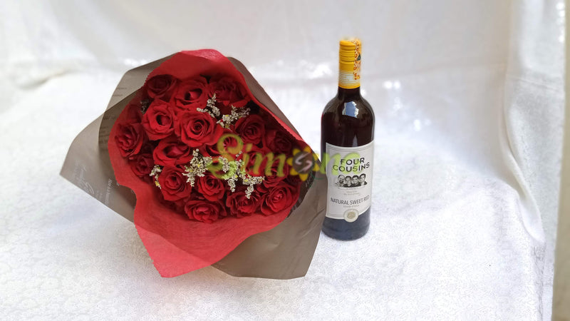 Delightful hand bouquet with red wine