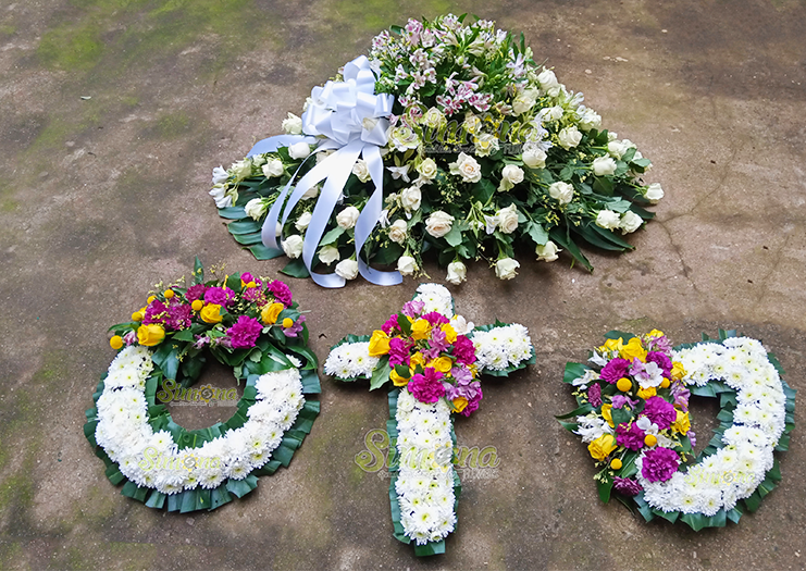 Devoted wreath set and casket spread flowers by Simona Flowers
