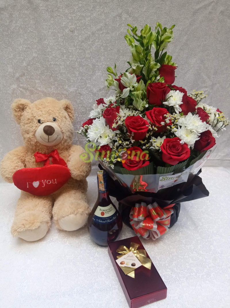 Diamond bouquet with red wine , Guylian chocolate and teddy bear