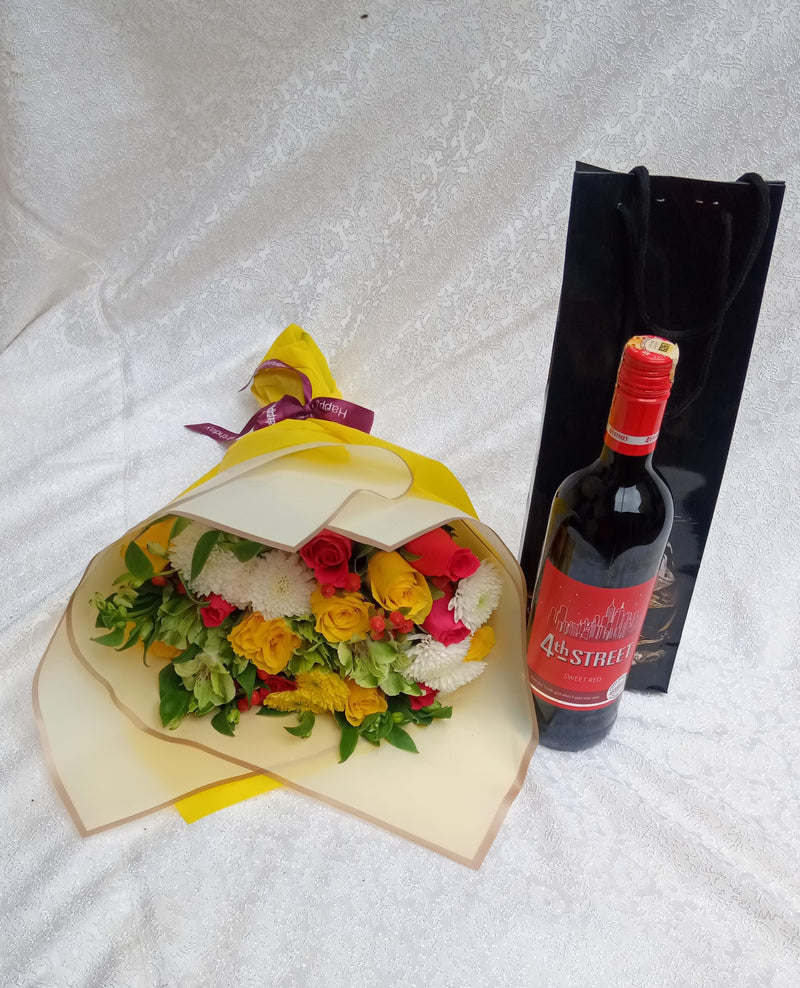 Janice bouquet pack of flowers and fourth street wine wine by Simona Flowers
