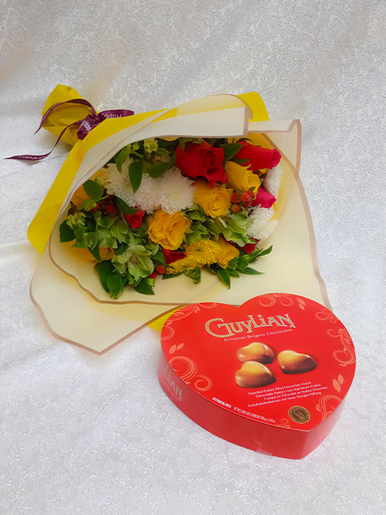 Janice package of a hand bouquet of flowers and Guylian heart shaped love chocolates
