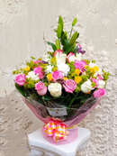 Water bouquet of roses and chrysanthemums and  complimenting flower fillers with a touch of lilies