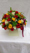 A box floral bouquet of button chrysanthemums, roses and flower fillers by Simona Flowers