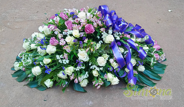 Comfort casket flower arrangement by Simona Flowers