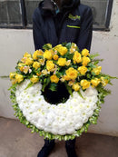 Executive glorious large round hand held funeral wreath by Simona Flowers