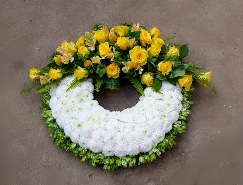 Executive glorious round funeral wreath by Simona Flowers