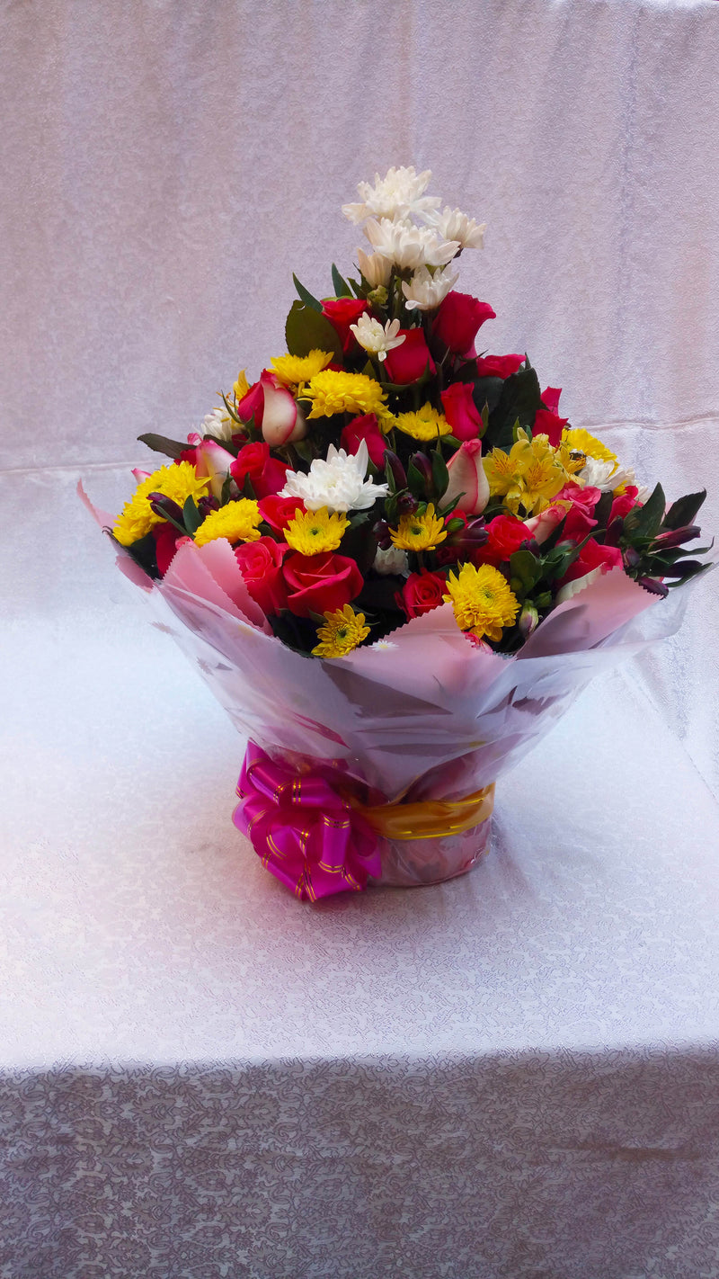 Water bouquet flower arrangement of chrysanthemums, a touch of roses and flower fillers
